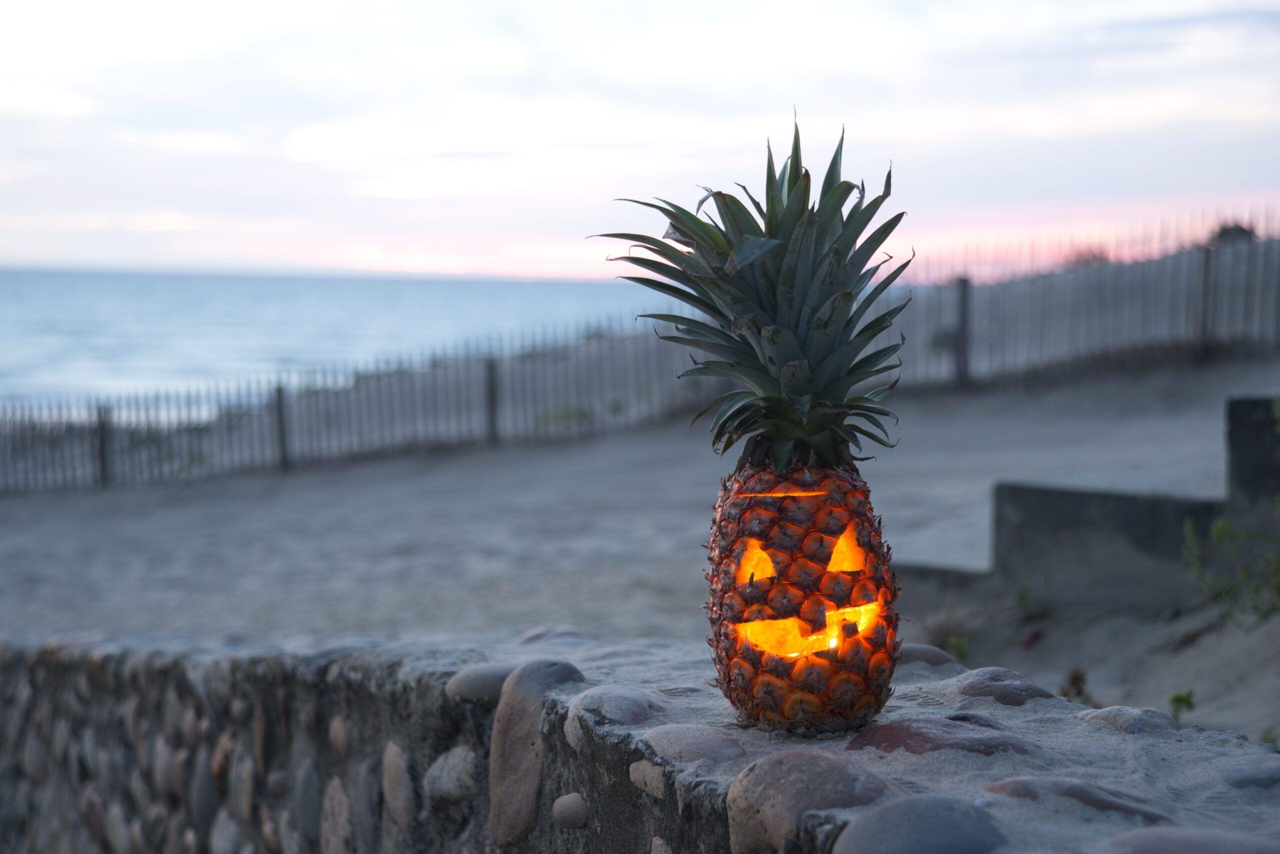 pineapple on beach turned into jackolantern