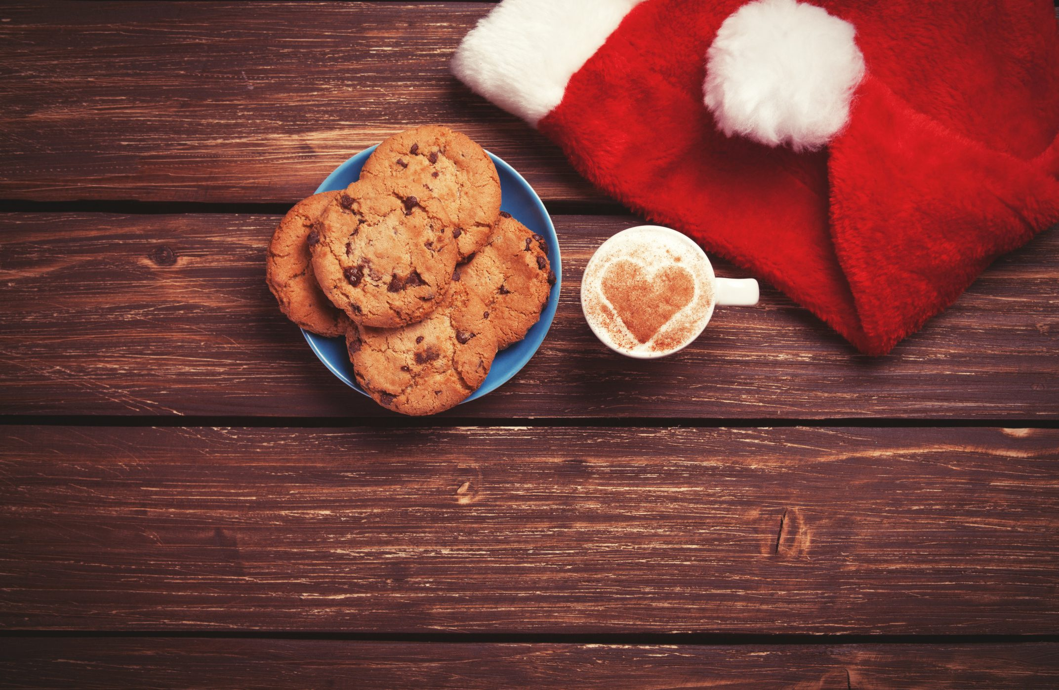 milk and cookies next to a Santa hat