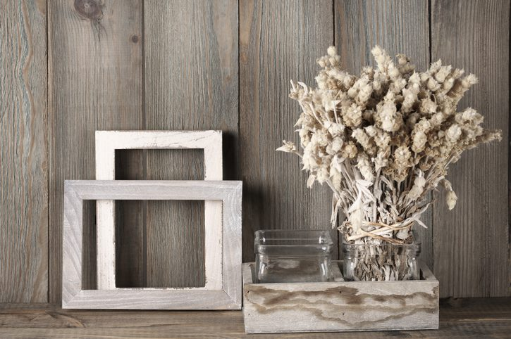 Frames and decor against wood background