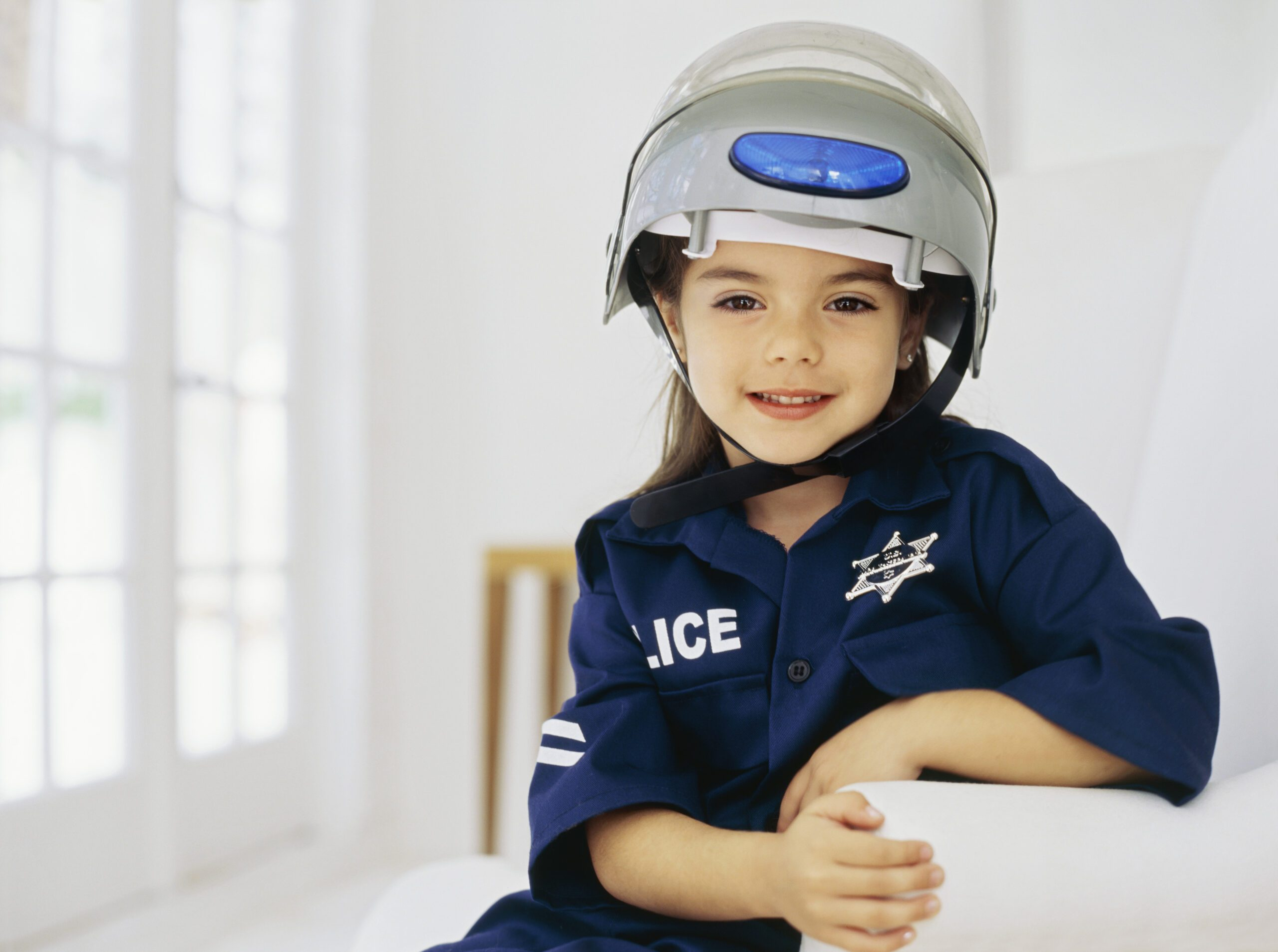 young girl dressed as a cop