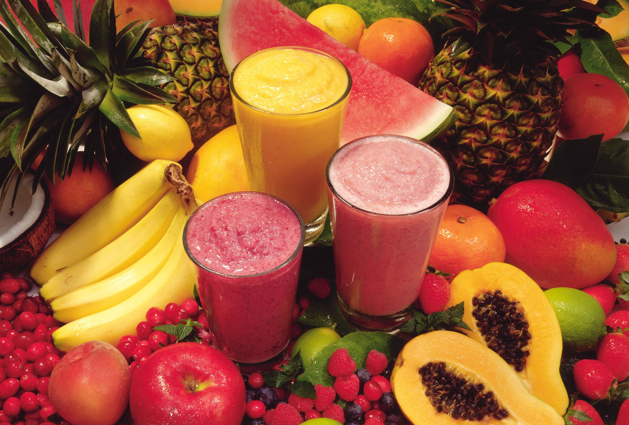 smoothies surrounded by fruit