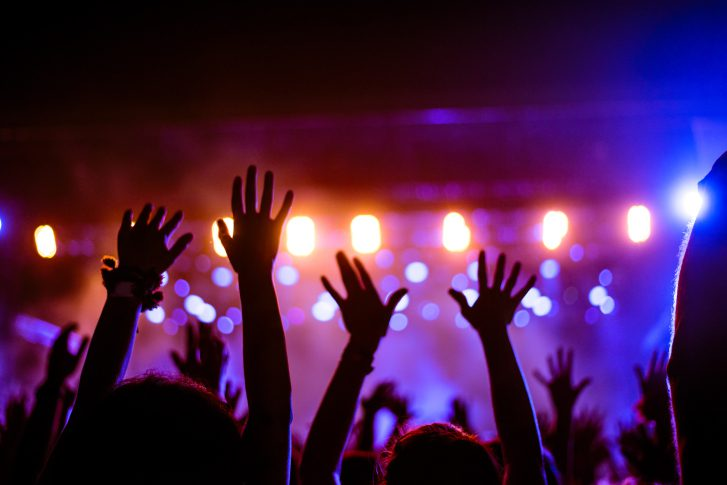 People hands in the air at a concert