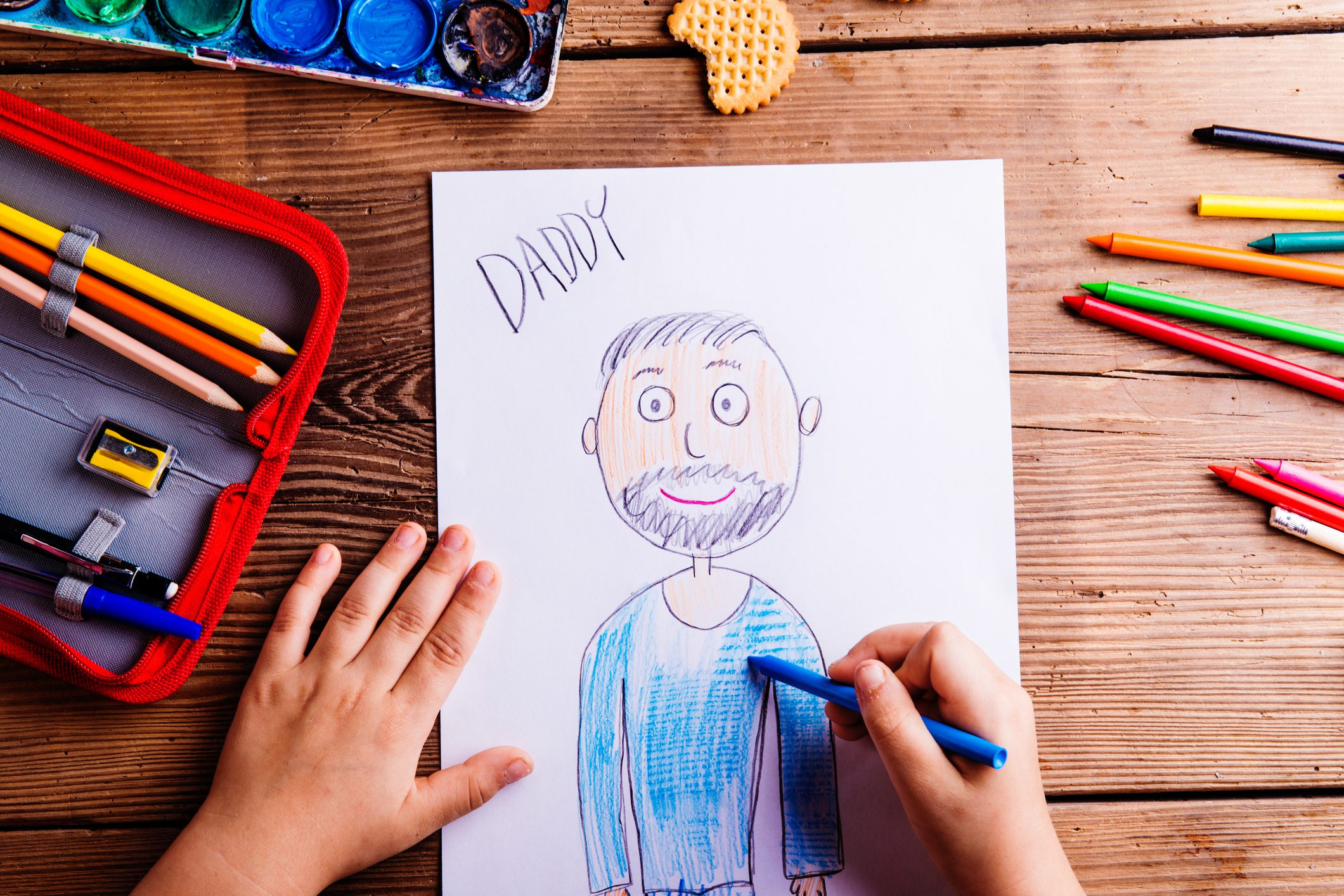 Picture of a dad, kid drawing