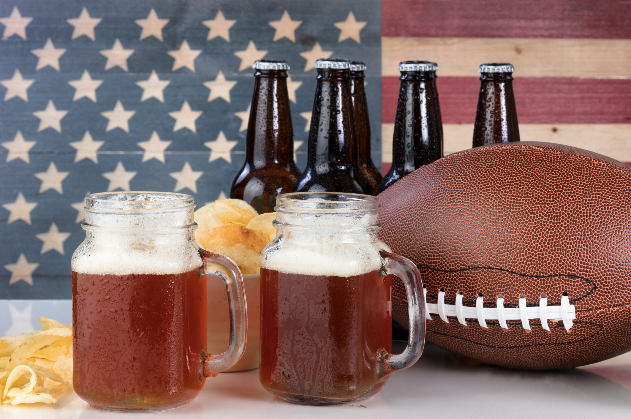 Beer in bottles and glasses and a football