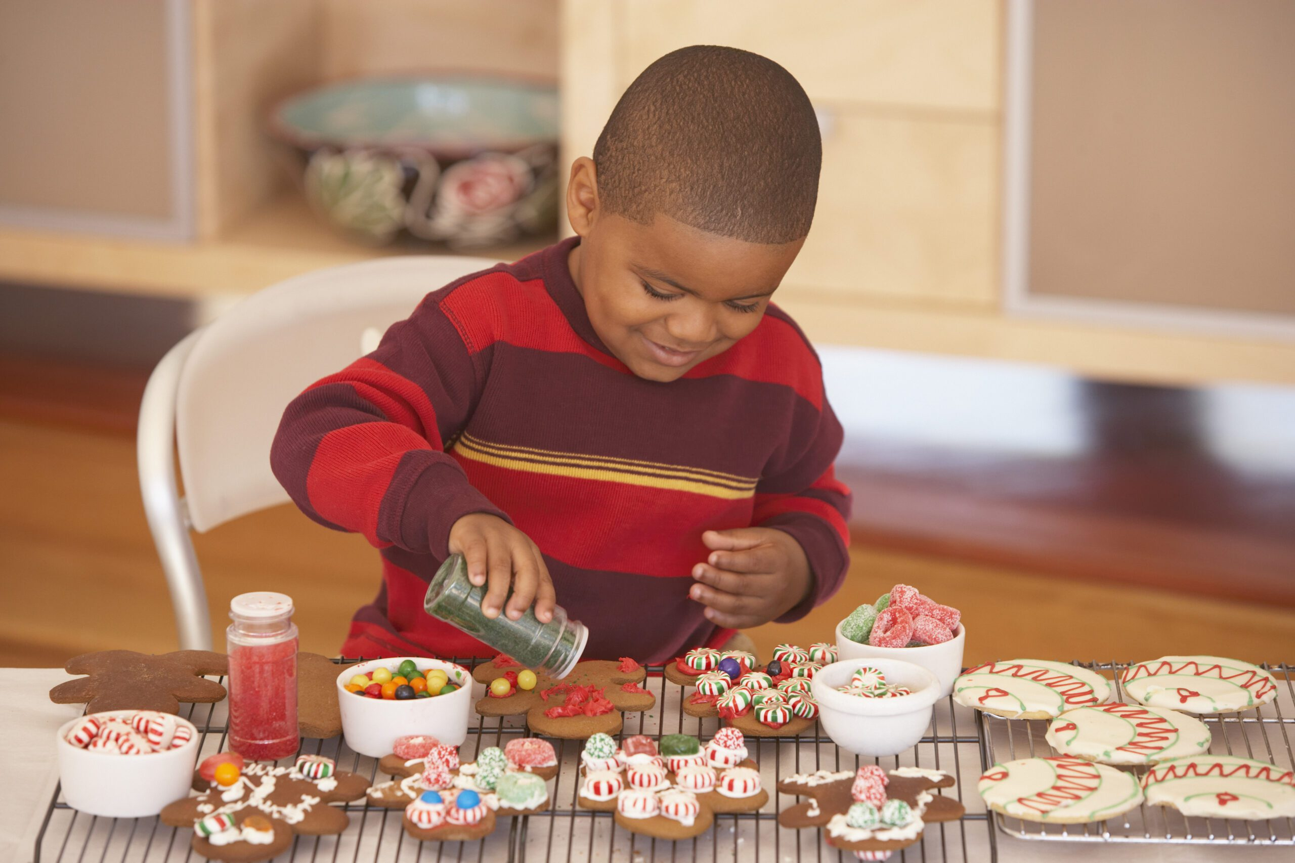 Cookie decorating with sprinkles and candy
