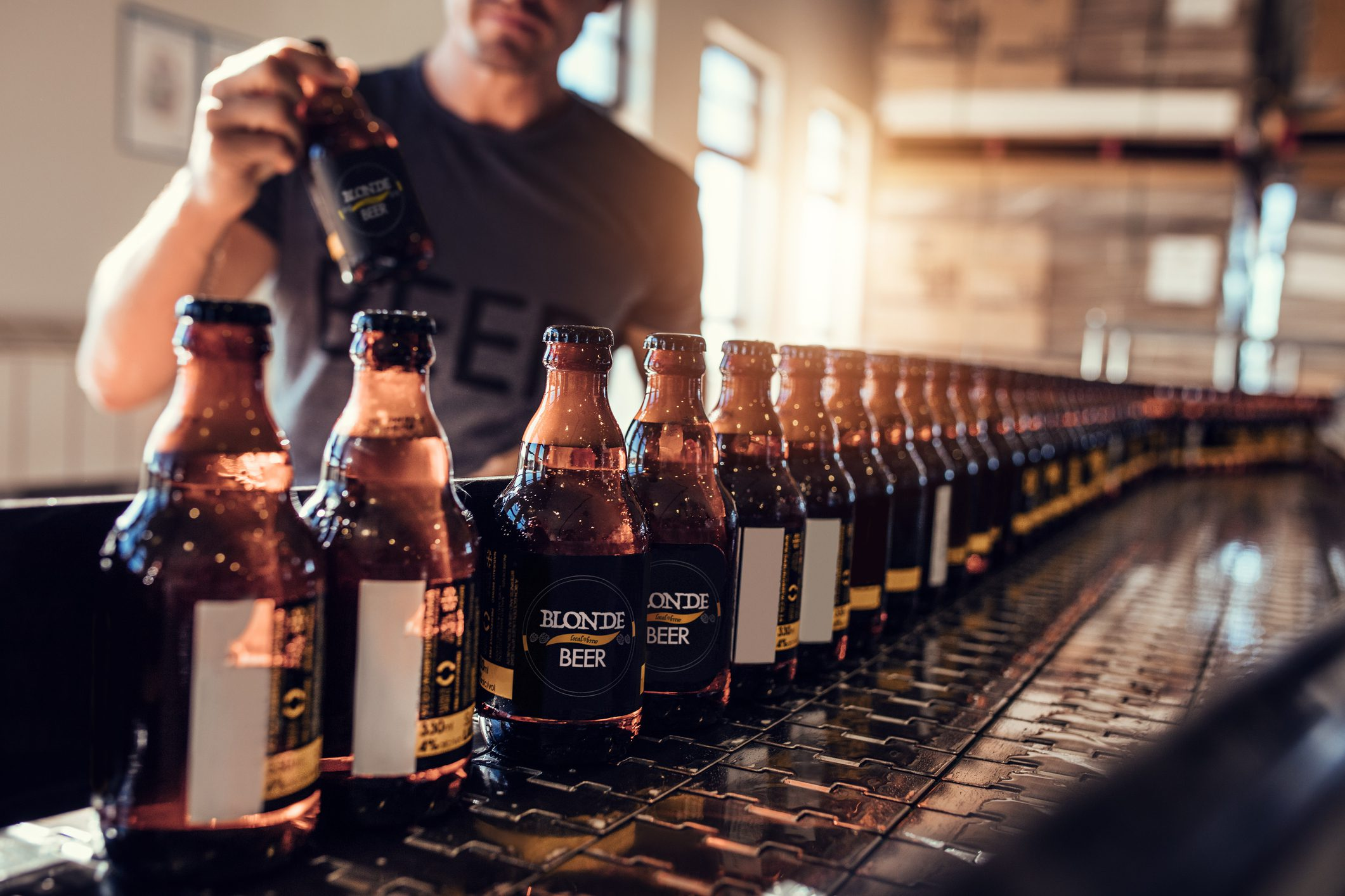 Beers lined up at the bar in bottle