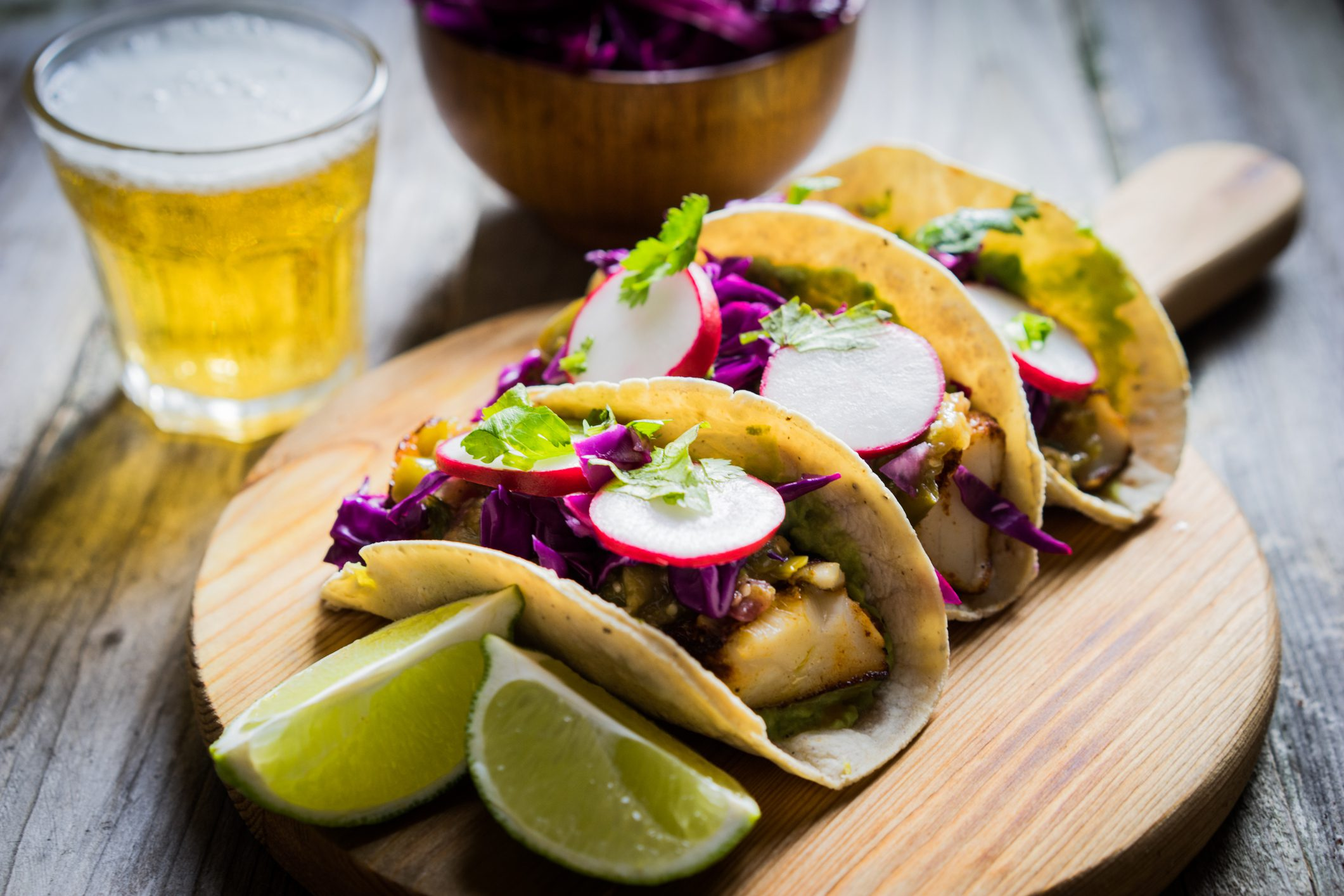 Street tacos with small glass of beer