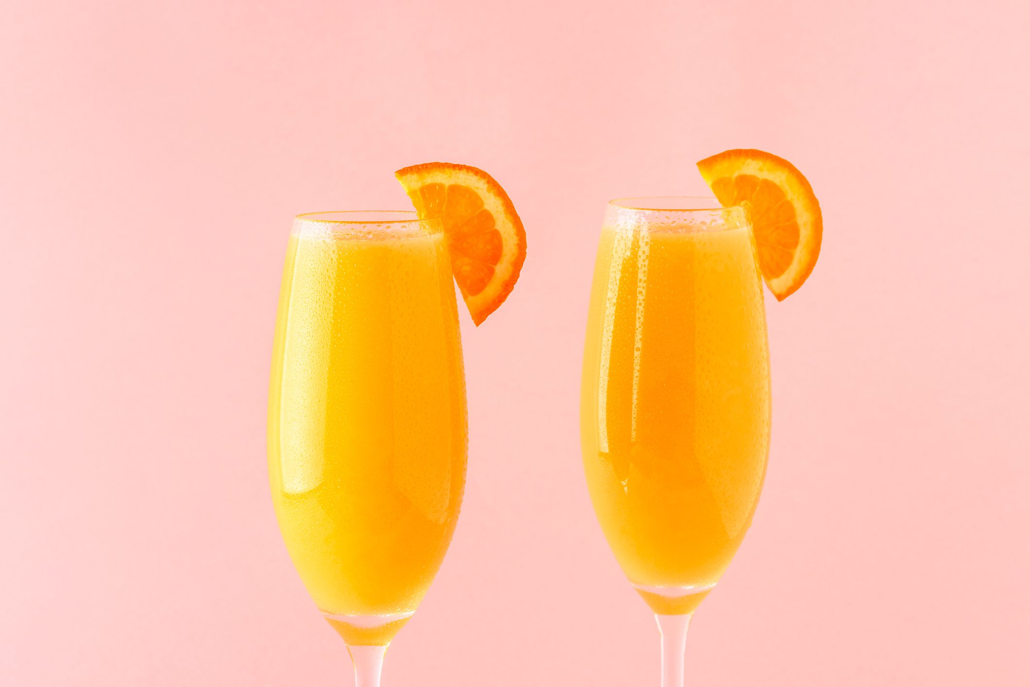 Yellow cocktail on a bright background