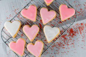 Small Heart Cookies On Cooling Rack over wax paper