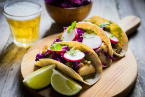 Tacos on wooden board