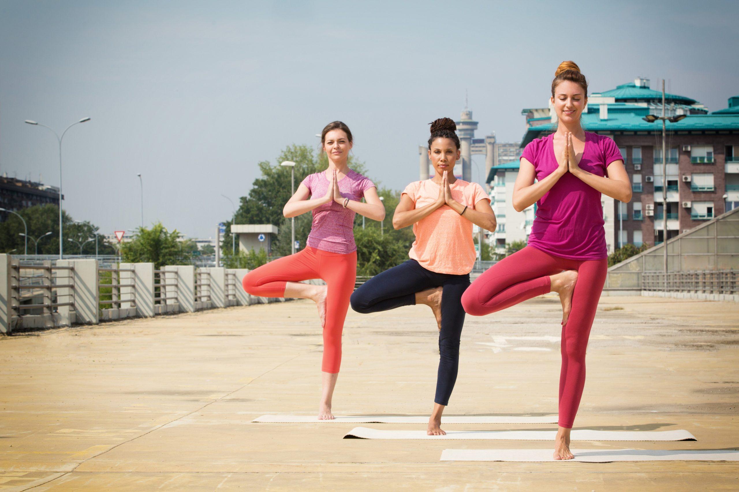 Women doing Yoga in an outdoor neighborhood