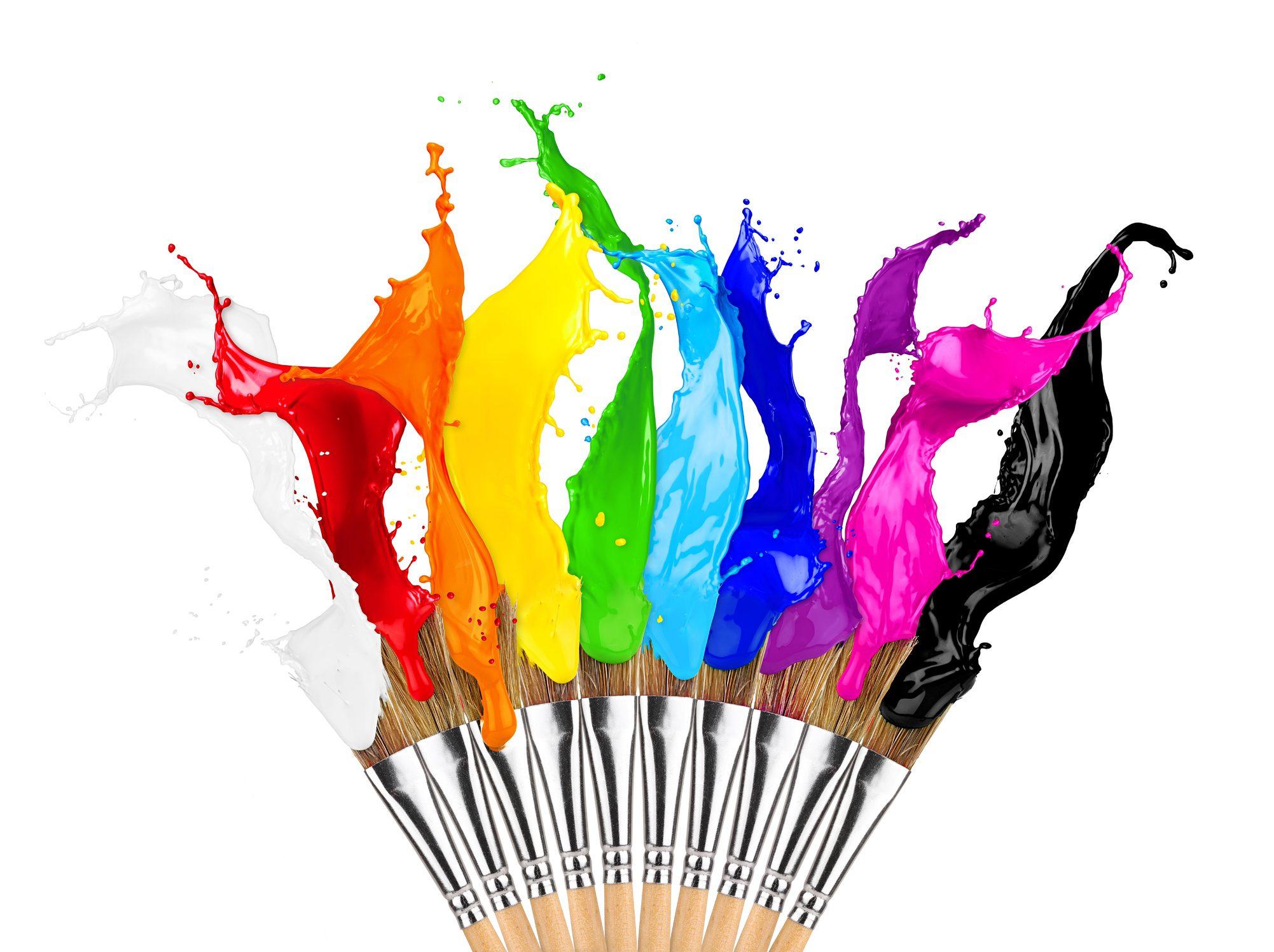Colorful paint splatter on brushes