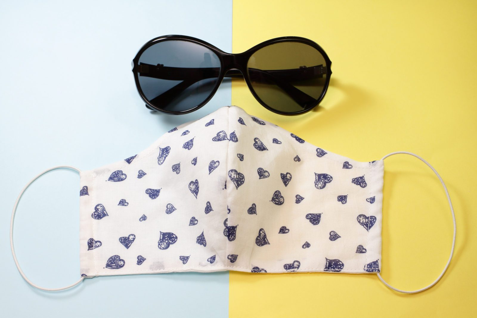 Black sunglasses and a protective face mask. Handmade rag bandage to protect against infection and viruses.