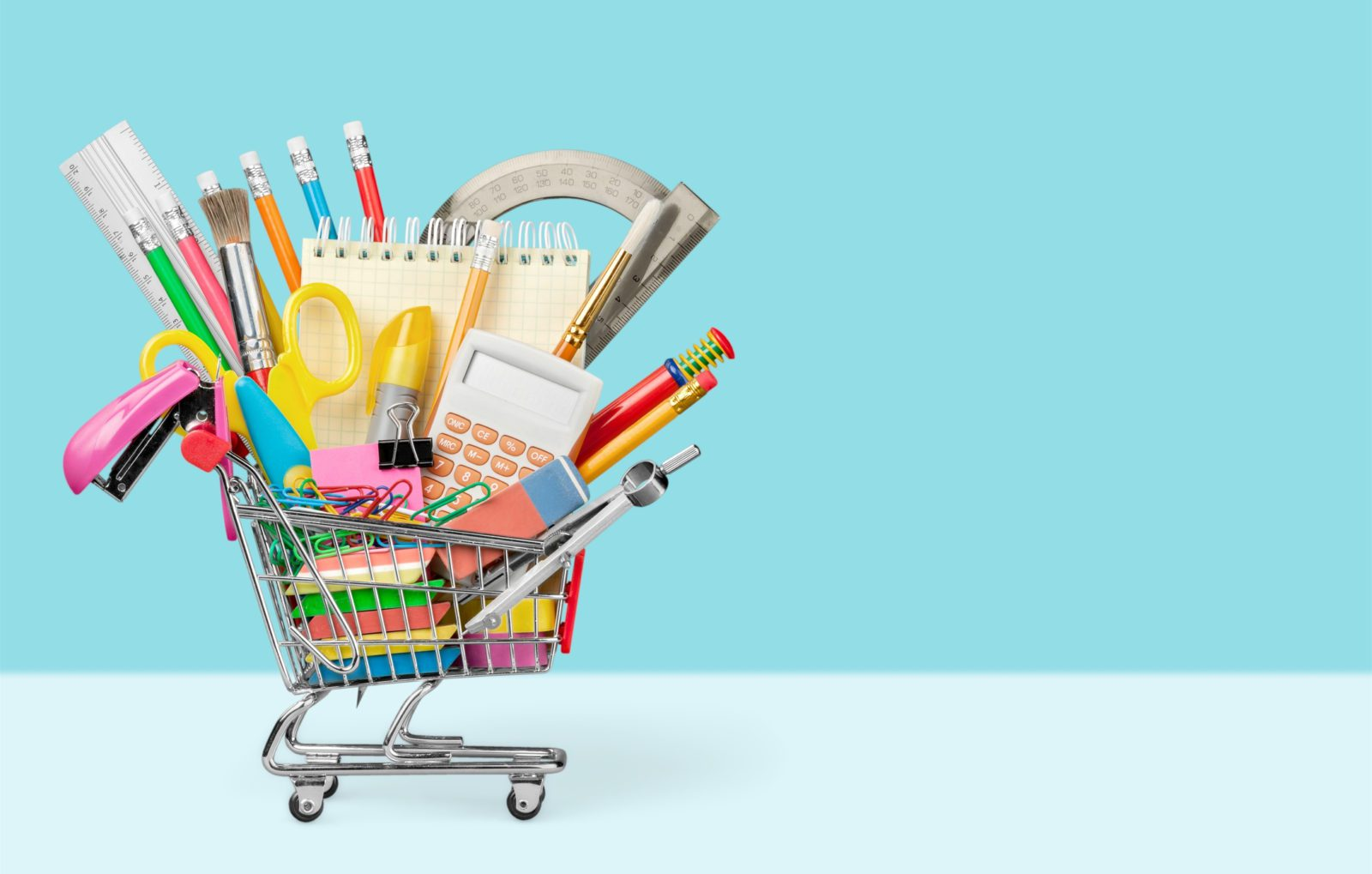 Back to school with shopping cart full of school tools