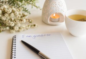"Notebook with ""I am grateful for"" in handwritten text"
