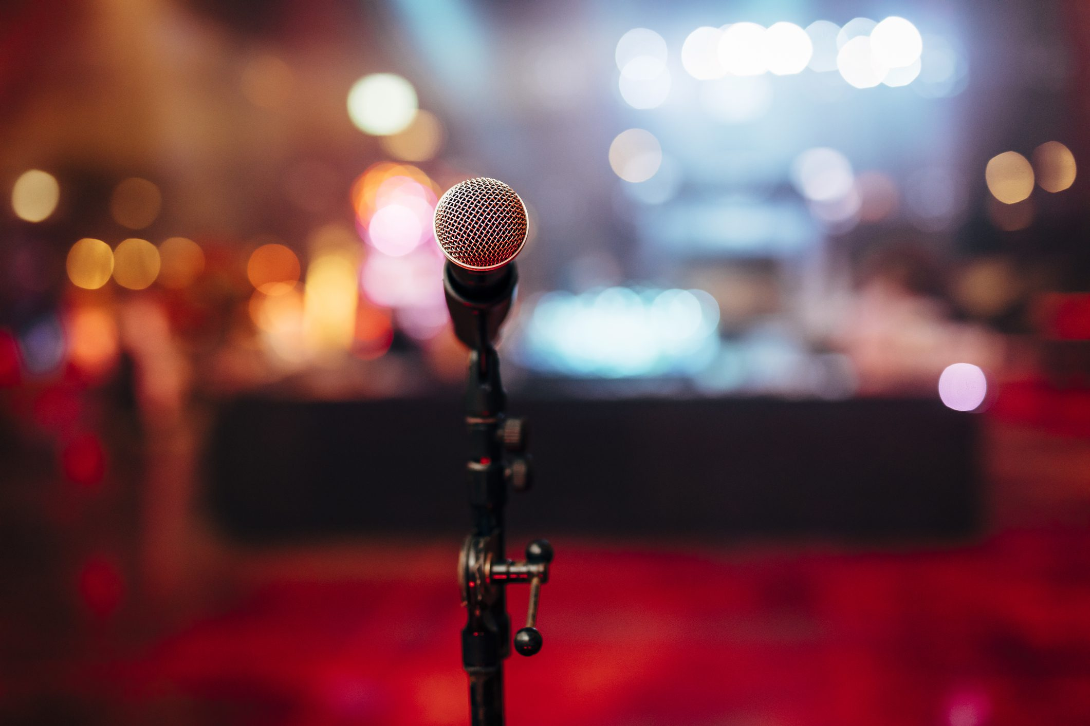 MIC ON A STAGE READY FOR THE SINGER OR SPEAKER